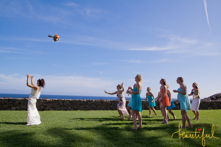 throwing the bouquet by Picture-Me-Beautiful-Wedding Photography-and-Film UK