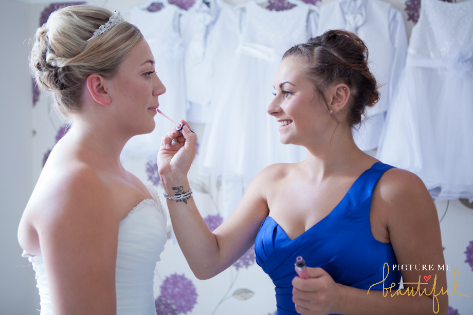 lipstick touch up for the bride by Picture Me Beautiful Wedding Photography and Film