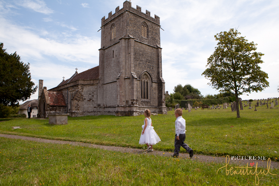 walking to the church by Picture Me Beautiful Wedding Photography and Film