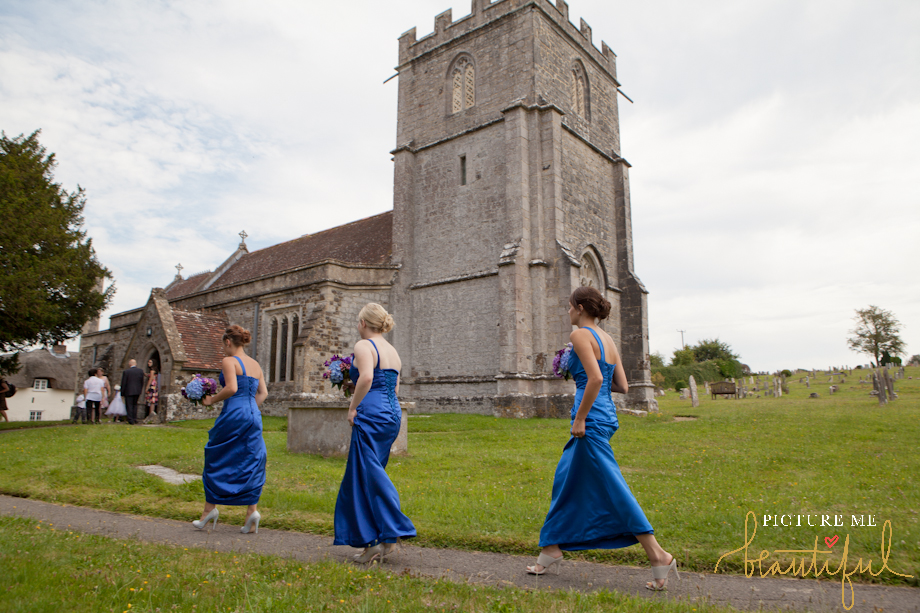 bridesmaids making their way to church by Picture Me Beautiful Wedding Photography and Film