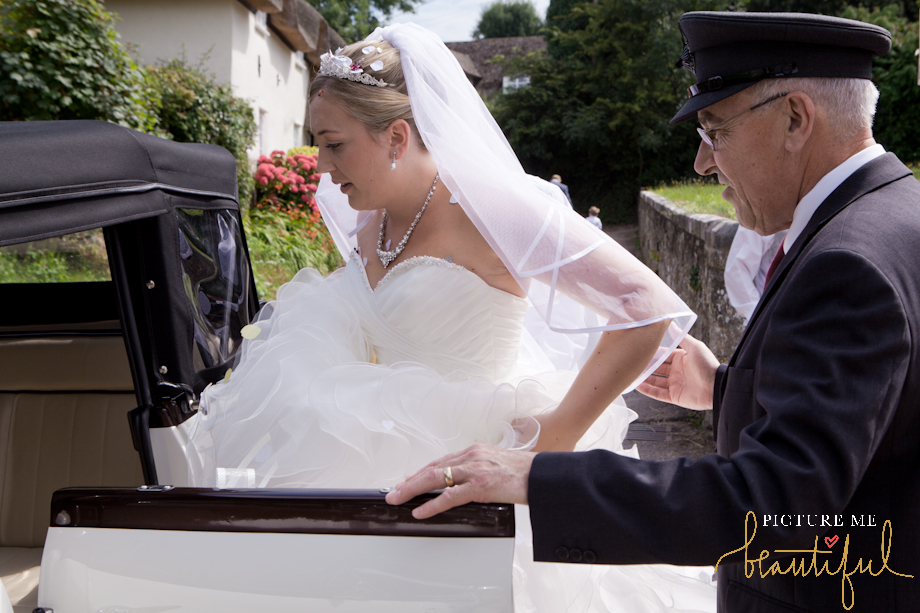 getting in the wedding car by Picture Me Beautiful Wedding Photography and Film