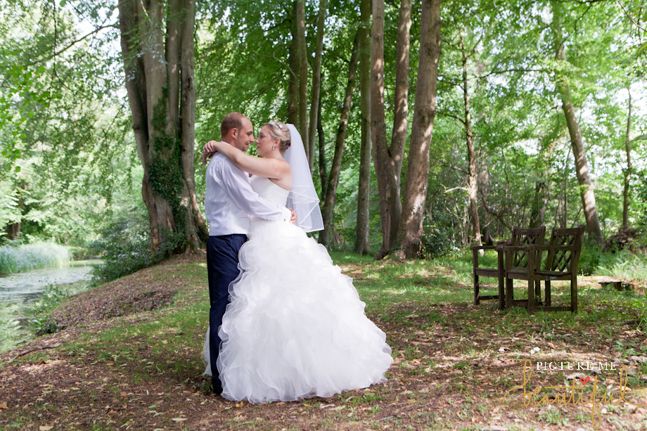 bride and groom in the woods by Picture Me Beautiful Wedding Photography and Film
