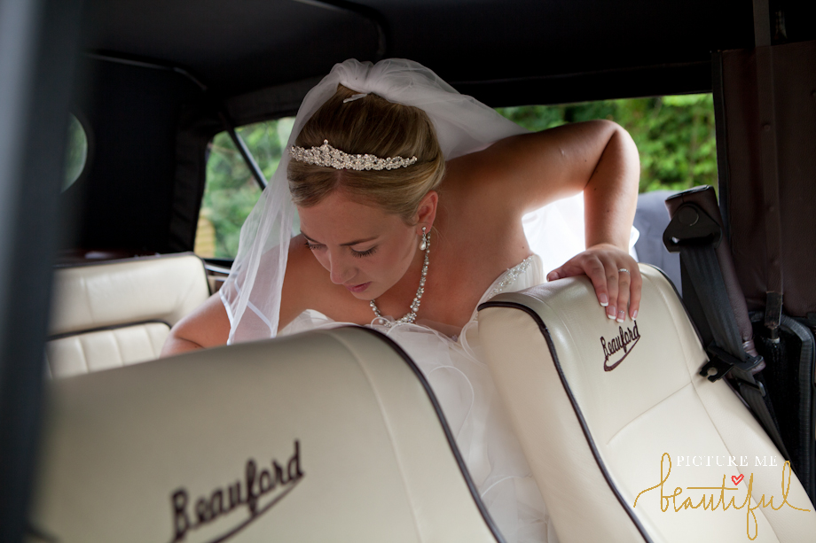 vintage Beauford convertible takes bride to reception by Picture Me Beautiful Wedding Photography and Film
