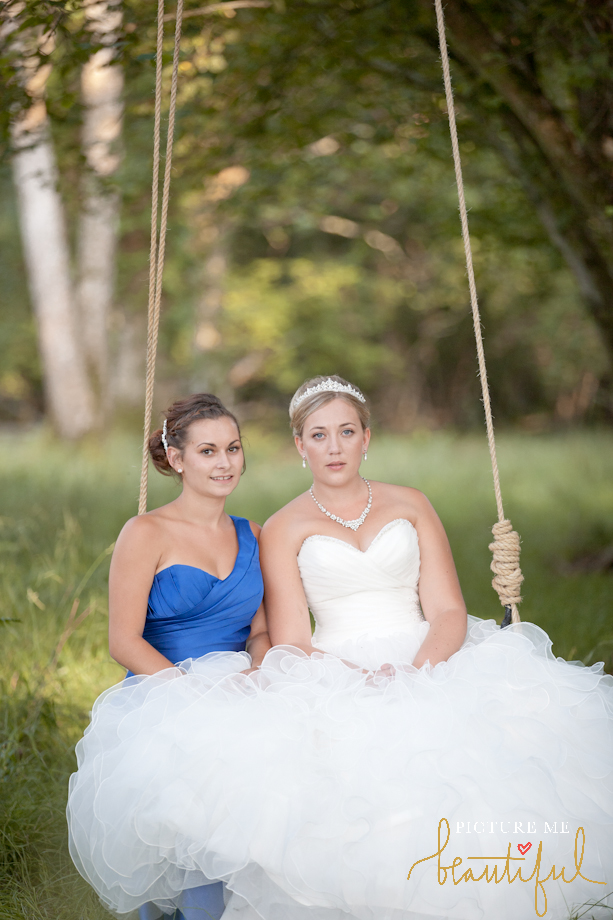 bride and bridesmaid by Picture Me Beautiful Wedding Photography and Film