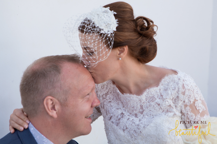 kiss by  Picture Me Beautiful Wedding Photography and Film